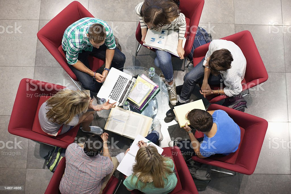 University students studying in a circle stock photo