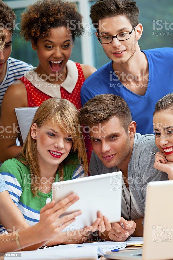 University students using a digital tablet royalty-free stock photo