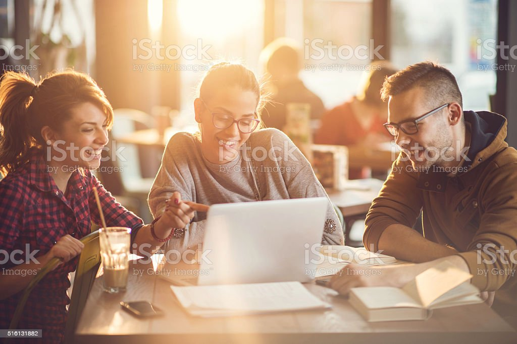 University students using computer for their research in a cafe. stock photo