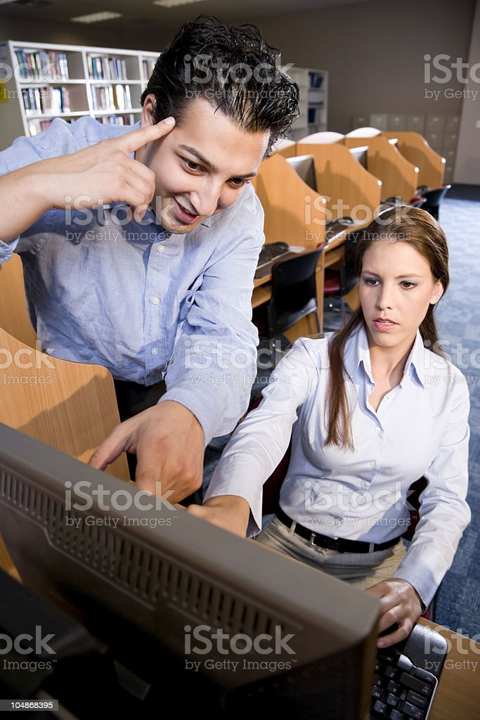 University students using computer in library royalty-free stock photo