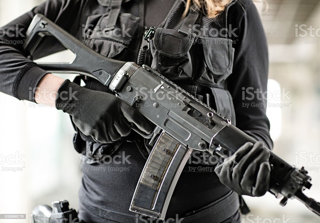 Unknown female swat team member posing with rifle stock photo