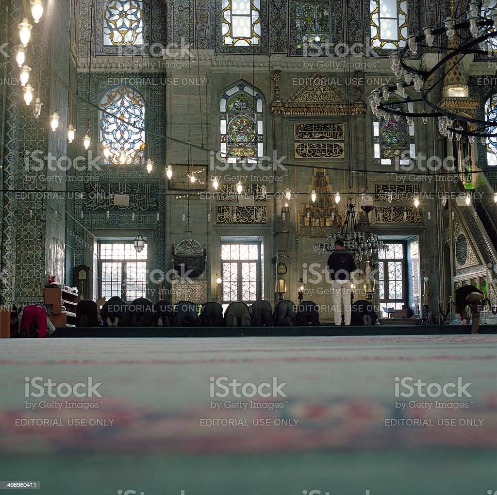 Unknown men praying in Blue Mosque in Istanbul, Turkey stock photo