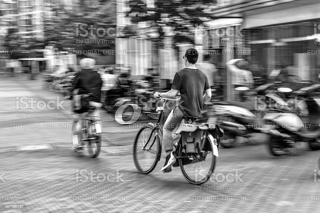 Unknown people cycling in The Hague, Netherlands stock photo