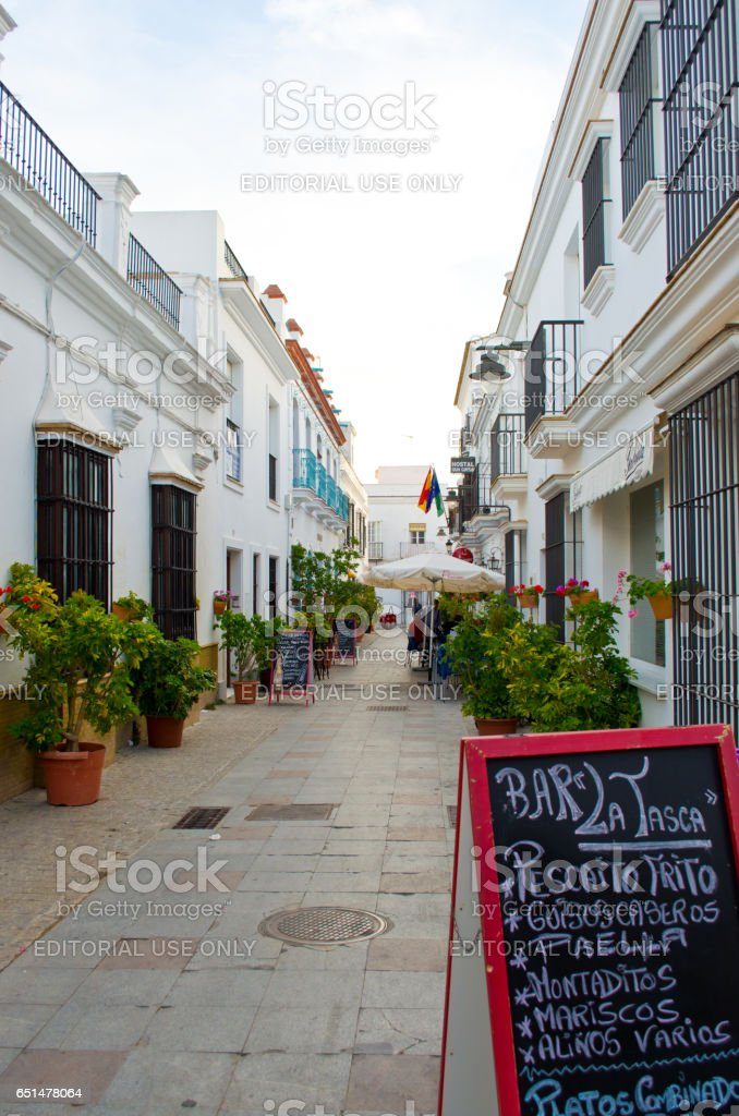 CHIPIONA, SPAIN - JUNE 10, 2013: Unknown people on city streets. City architecture. Chipiona municipality and the beach resort on the bank of the Atlantic Ocean in Andalusia. stock photo