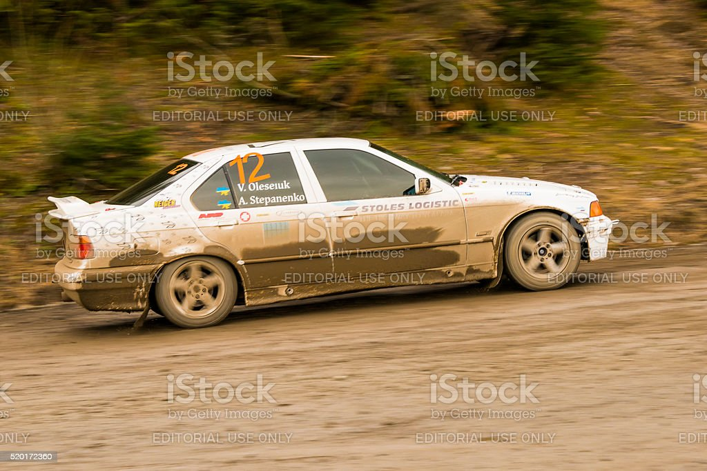 Unknown racer  on the car brand BMW  overcome the track stock photo