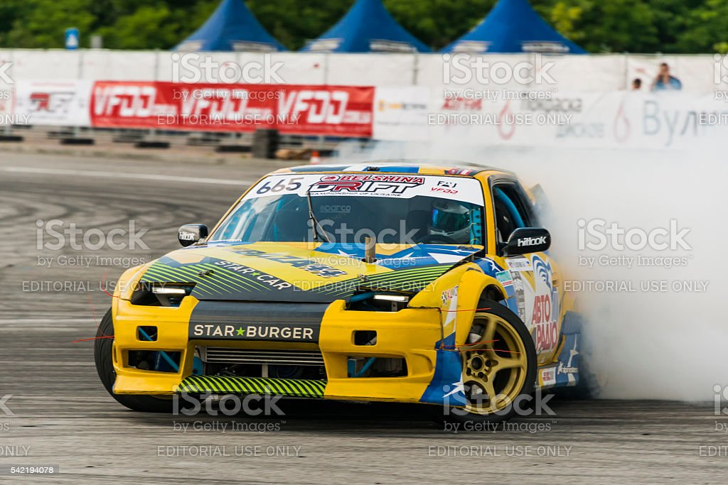Unknown rider on the car brand Nissan overcomes the track stock photo