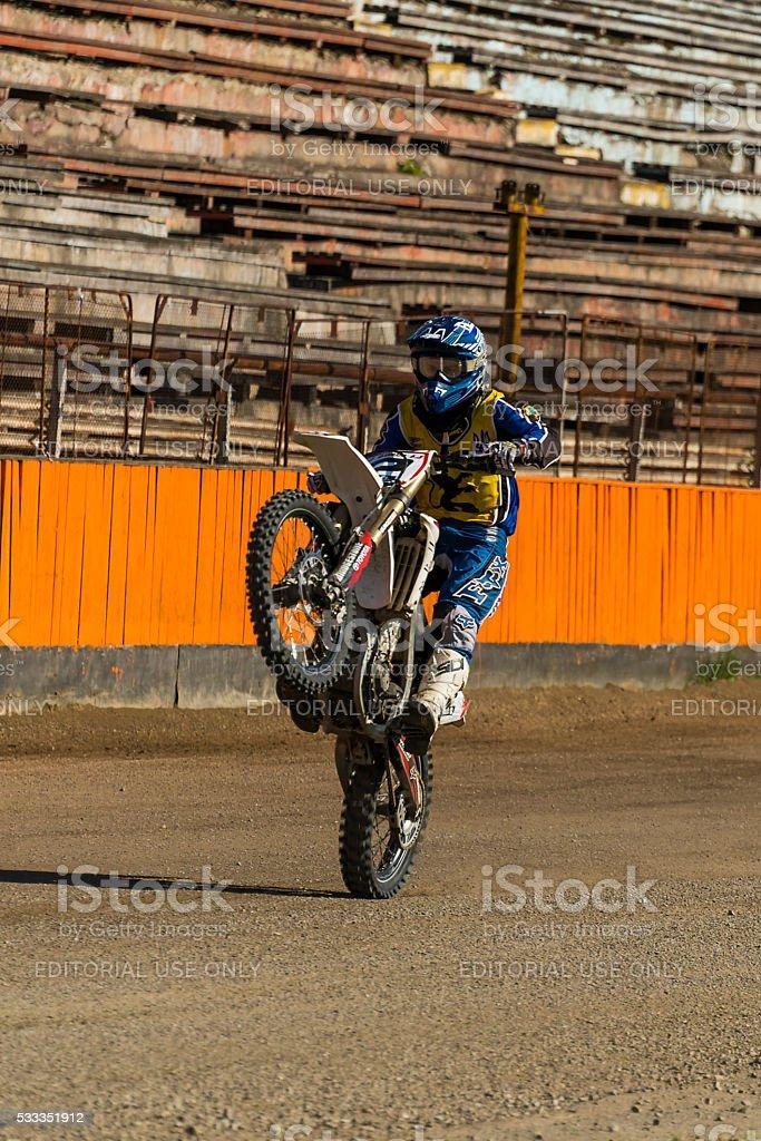 Unknown rider overcome a track stock photo