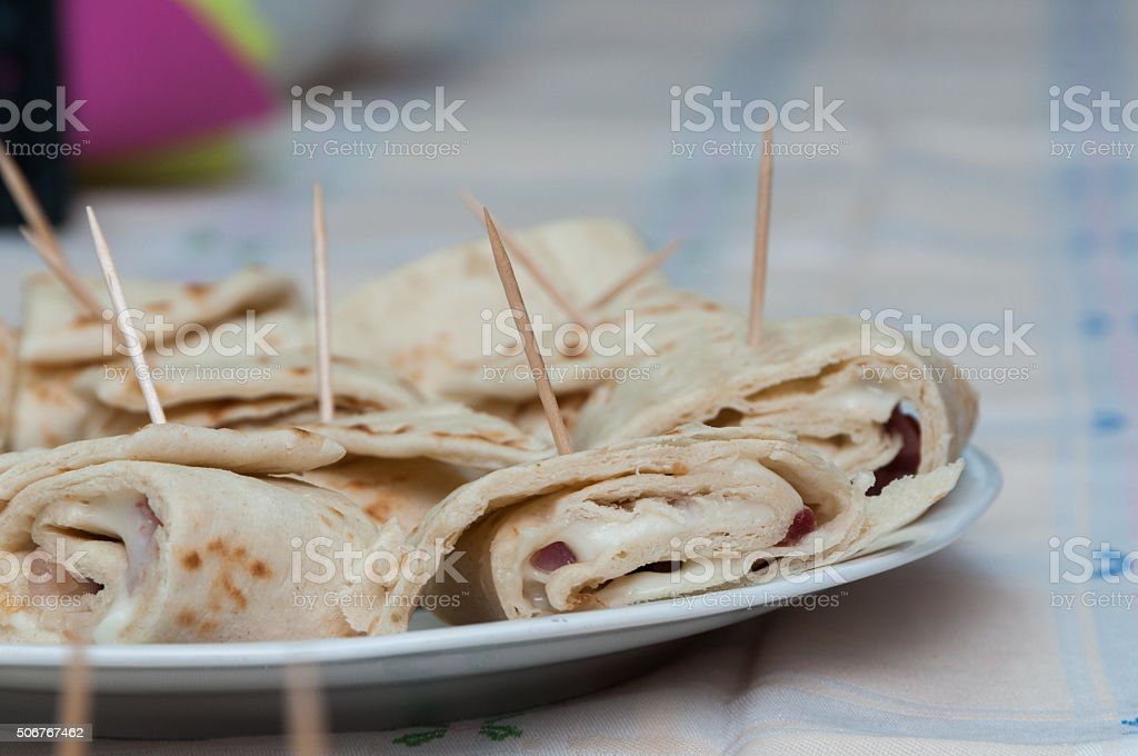 Unleavened Bread Roll with Diced Salami and Cheese stock photo