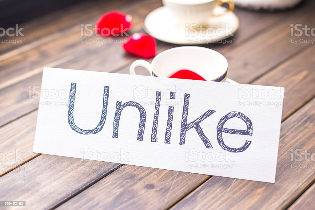 unlike on paper in cafe stock photo