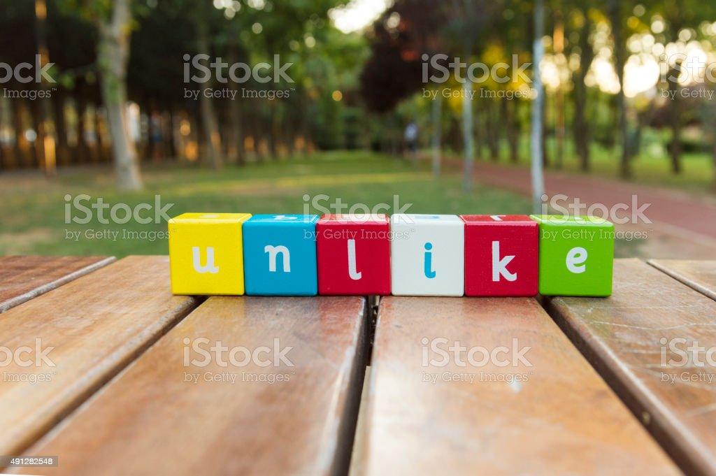Unlike, word stock photo