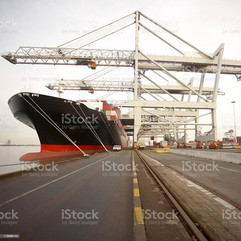 Unloading a container ship stock photo