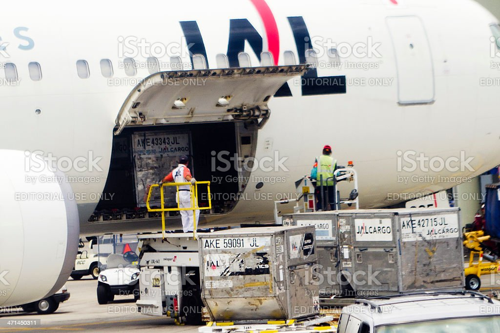 unloading air cargo stock photo