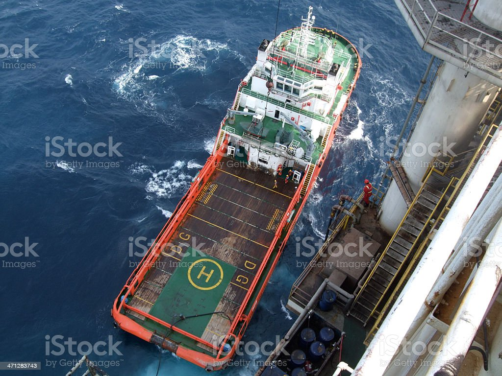 Unloading an offshore supply boat stock photo
