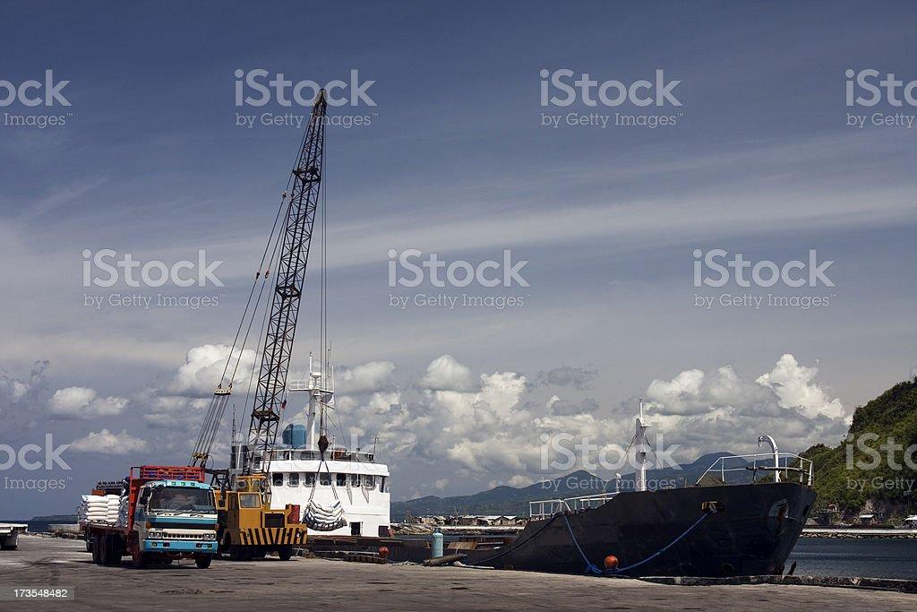 Unloading cargo ship stock photo