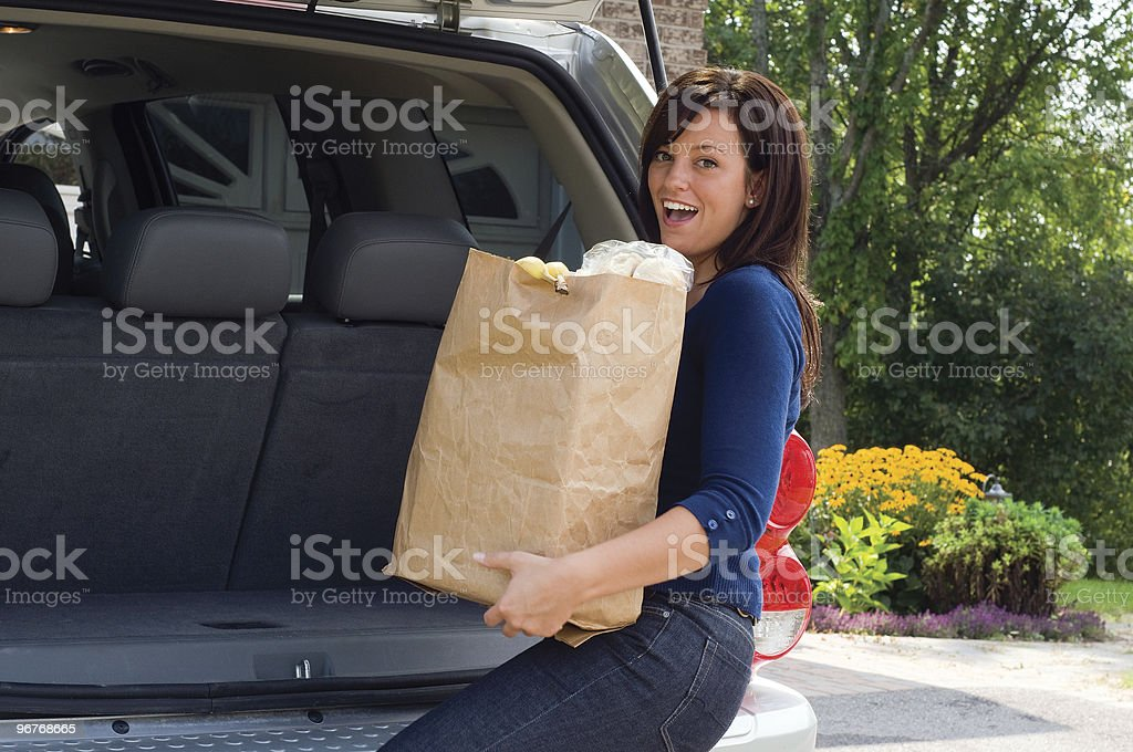 Unloading Her Shopping royalty-free stock photo