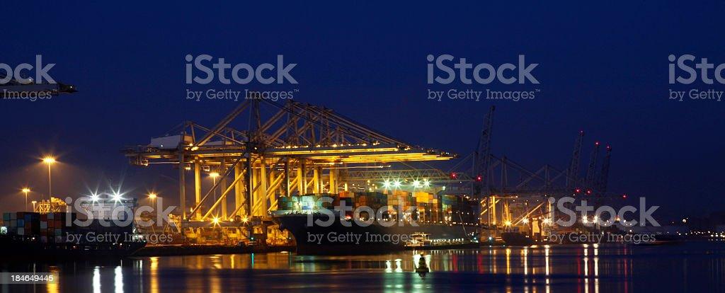 Unloading of a cargo ship stock photo