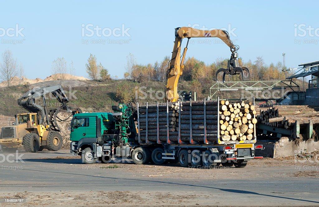 Unloading of Logging Truck royalty-free stock photo