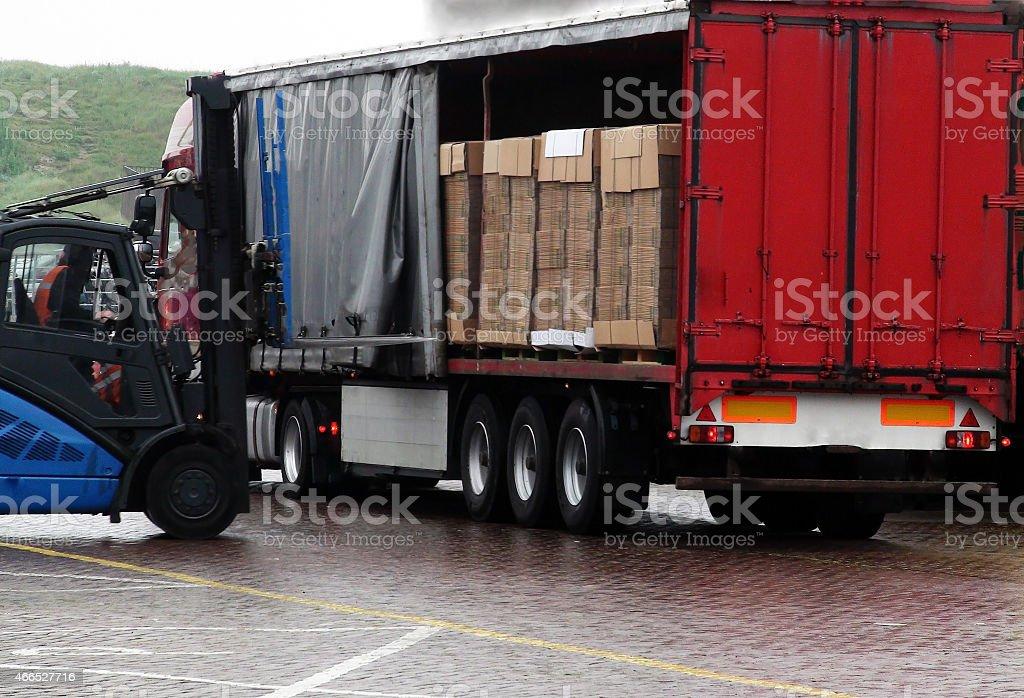 Unloading of truck stock photo