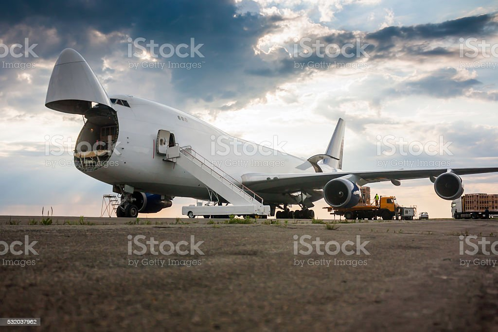 Unloading wide body cargo airplane royalty-free stock photo