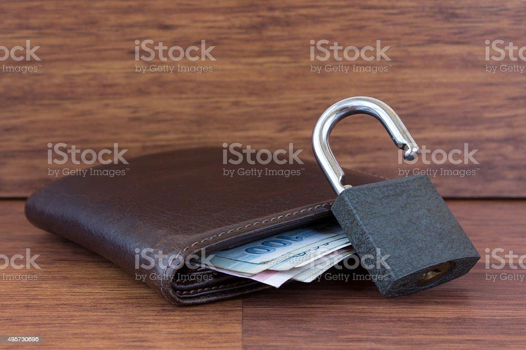 Unlocked padlock,wallet and money stock photo