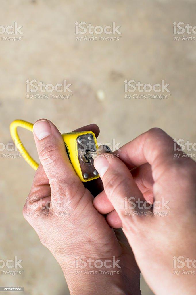 Unlocking close up of hands key and lock stock photo