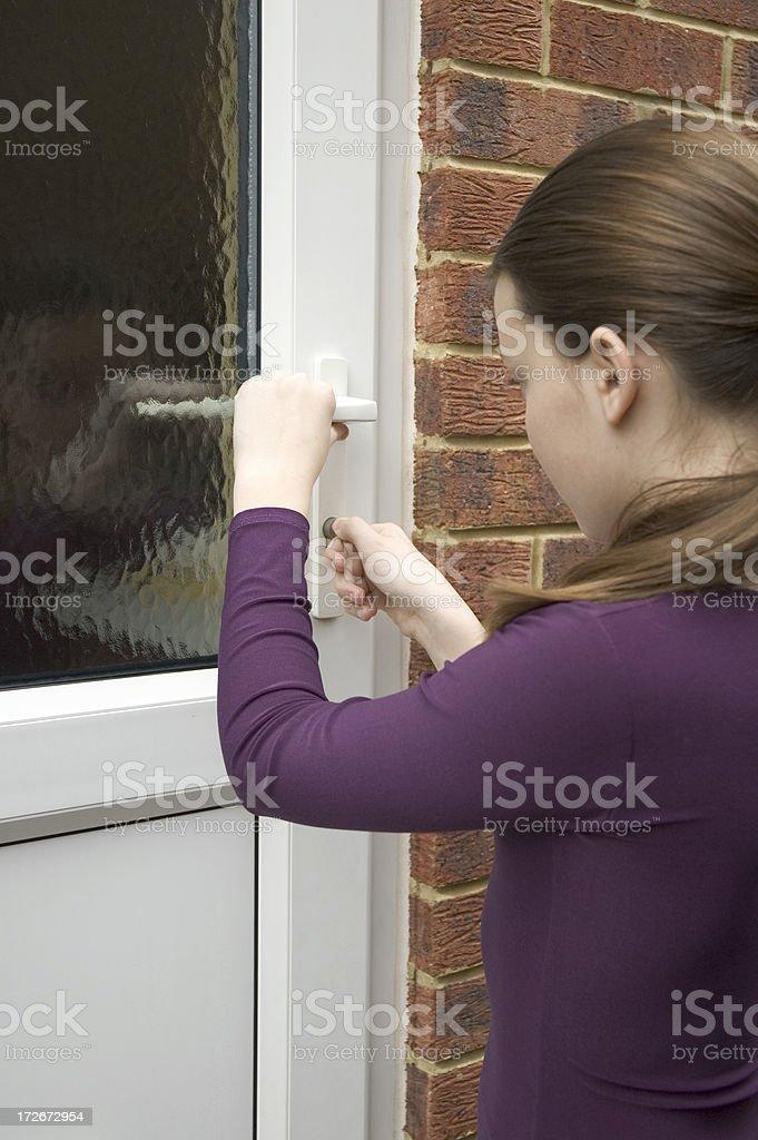 Unlocking the door stock photo