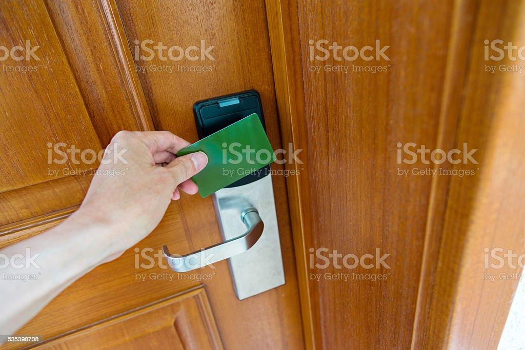 Unlocking the hotel room stock photo