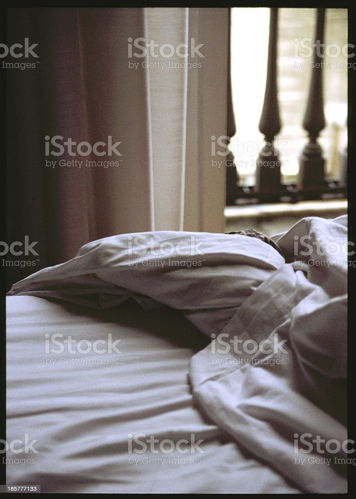 unmade bed royalty-free stock photo