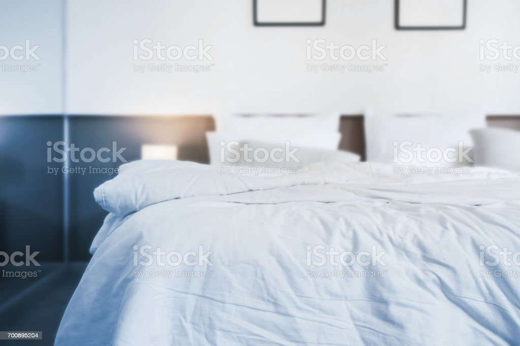 unmade bed stock photo