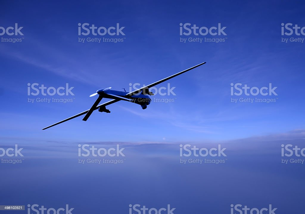 Unmanned drone in flight at dusk stock photo