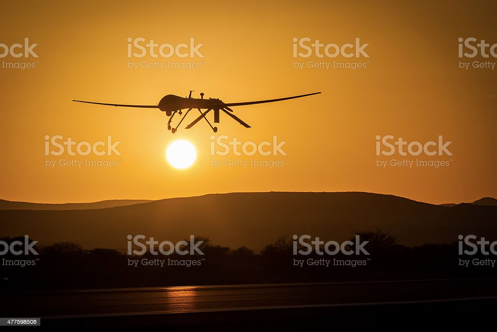 unmanned drone low pass in sunset panorama landscape stock photo