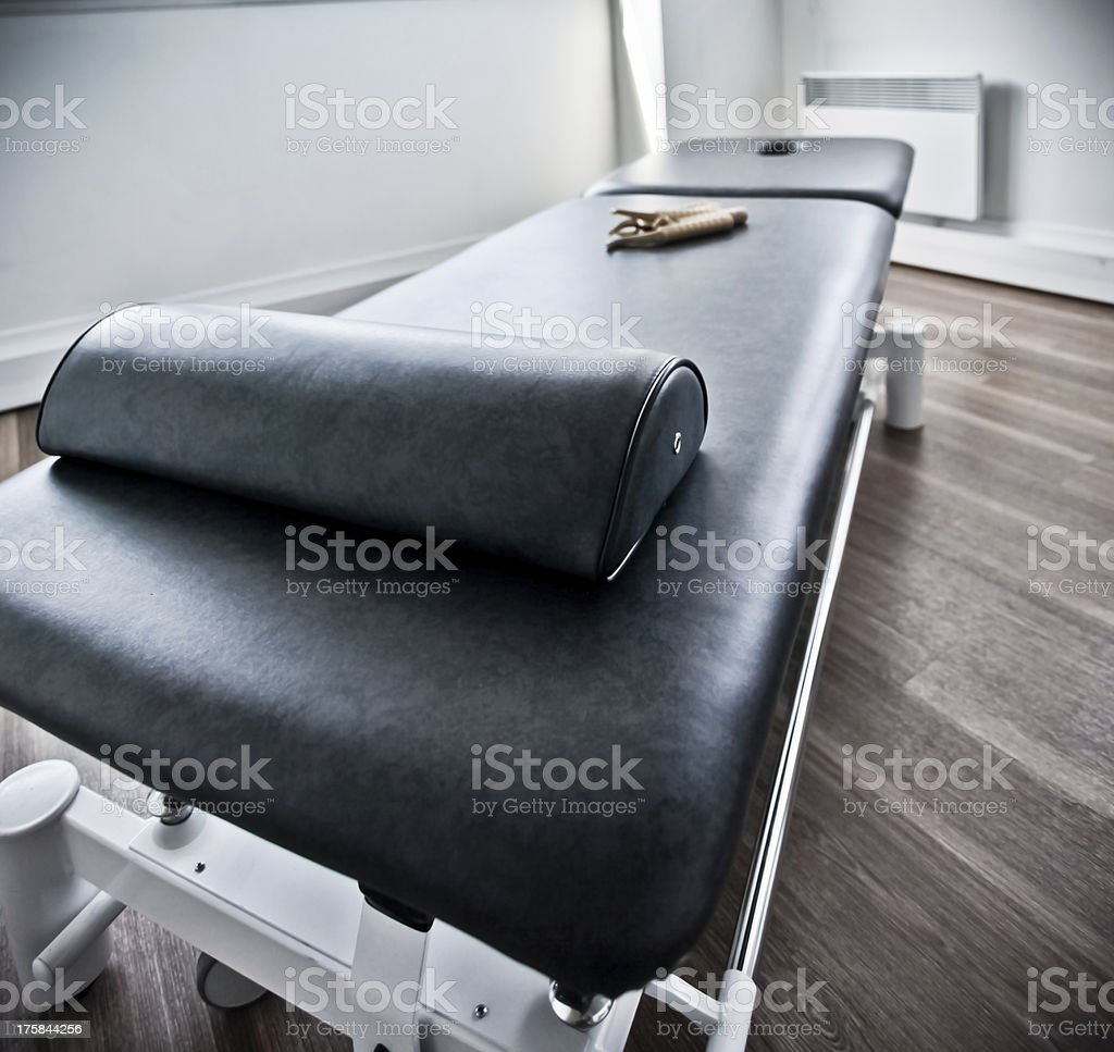 Unoccupied physiotherapy table stock photo