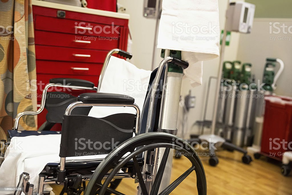 Unoccupied wheelchair in a hospital room stock photo