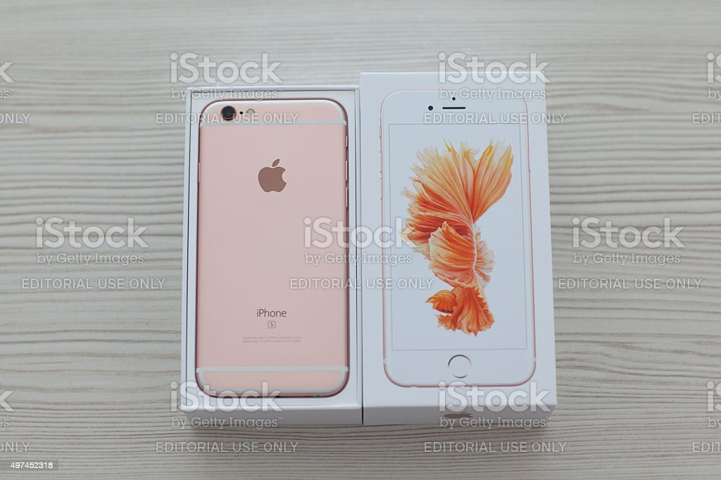 Unpack iPhone 6S Rose Gold on the table stock photo