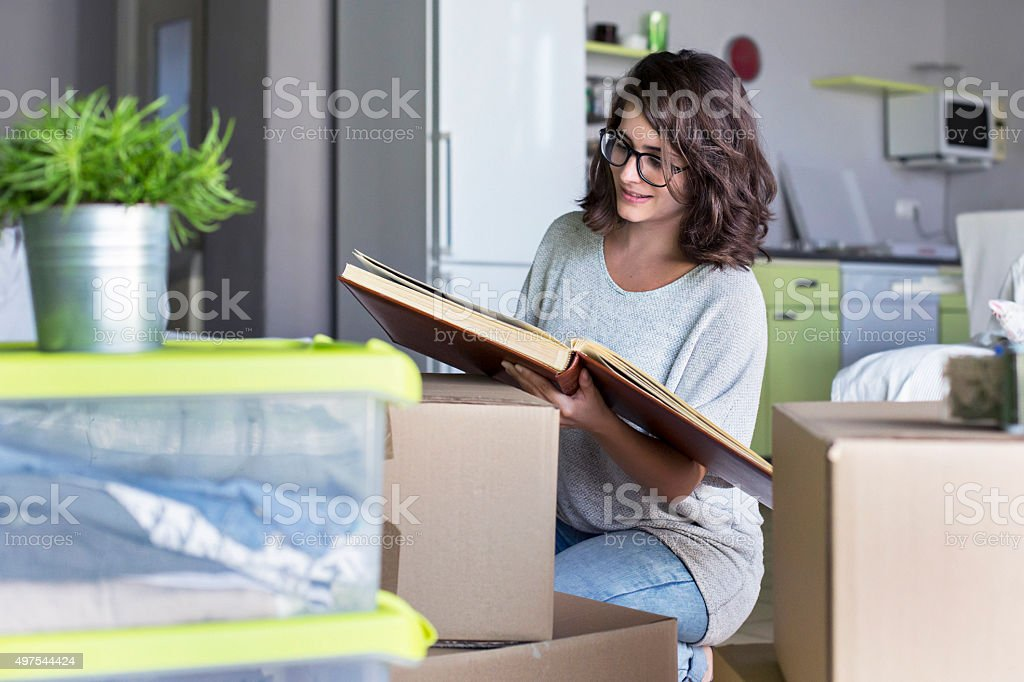 Unpacking boxes at her new home stock photo