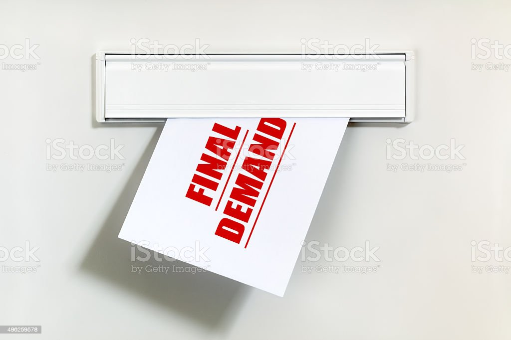 Unpaid bill through the letterbox stock photo