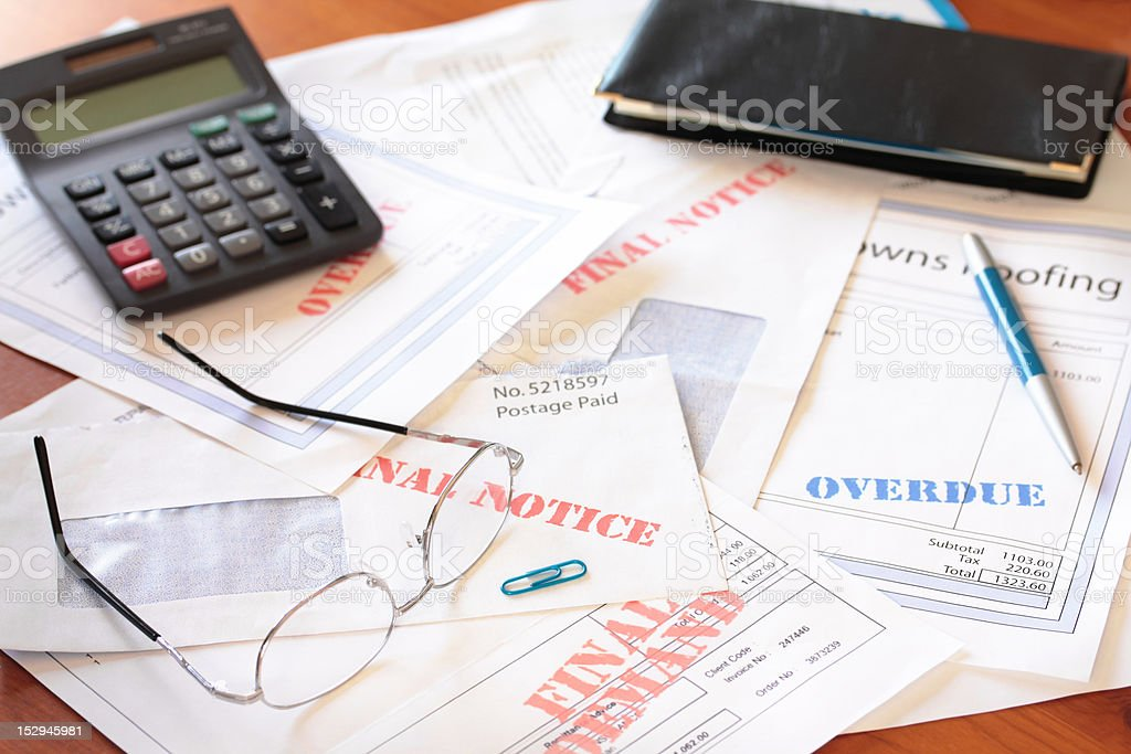 Unpaid Bills on Table with Calculator royalty-free stock photo