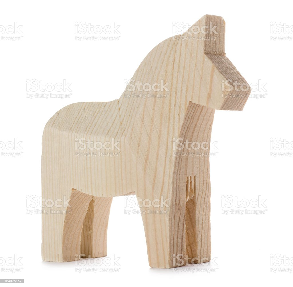 Unpainted wooden Swedish Dalecarlian horse isolated on a white background stock photo