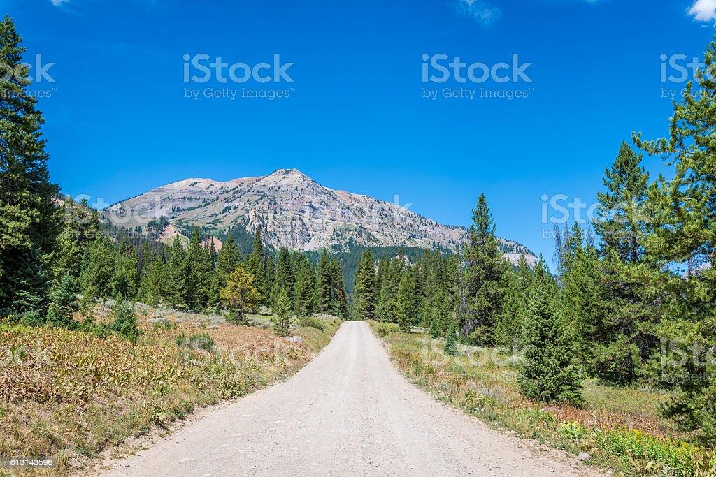 Unpaved mountain road stock photo