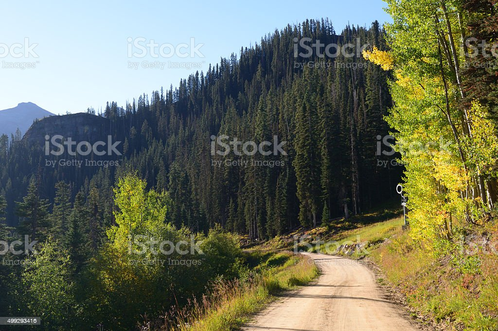 Unpaved road from a ski resort in Telluride stock photo