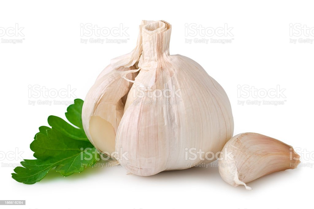 Unpeeled garlic cloves on white background royalty-free stock photo