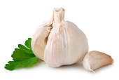 Unpeeled garlic cloves on white background