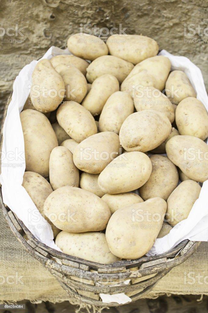 Unpeeled potatoes stock photo