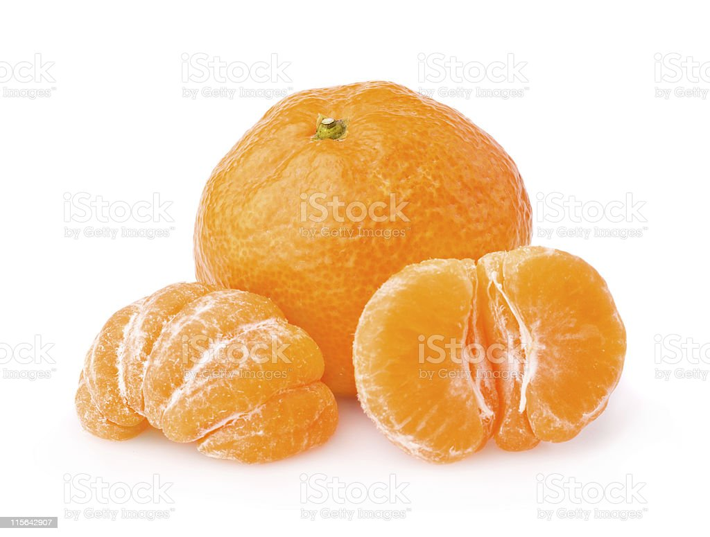 Unpeeled tangerine behind a peeled one  royalty-free stock photo