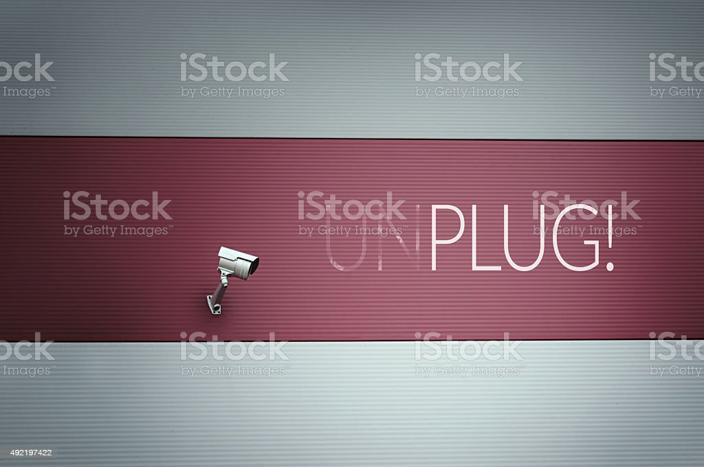 Unplug text on wall stock photo