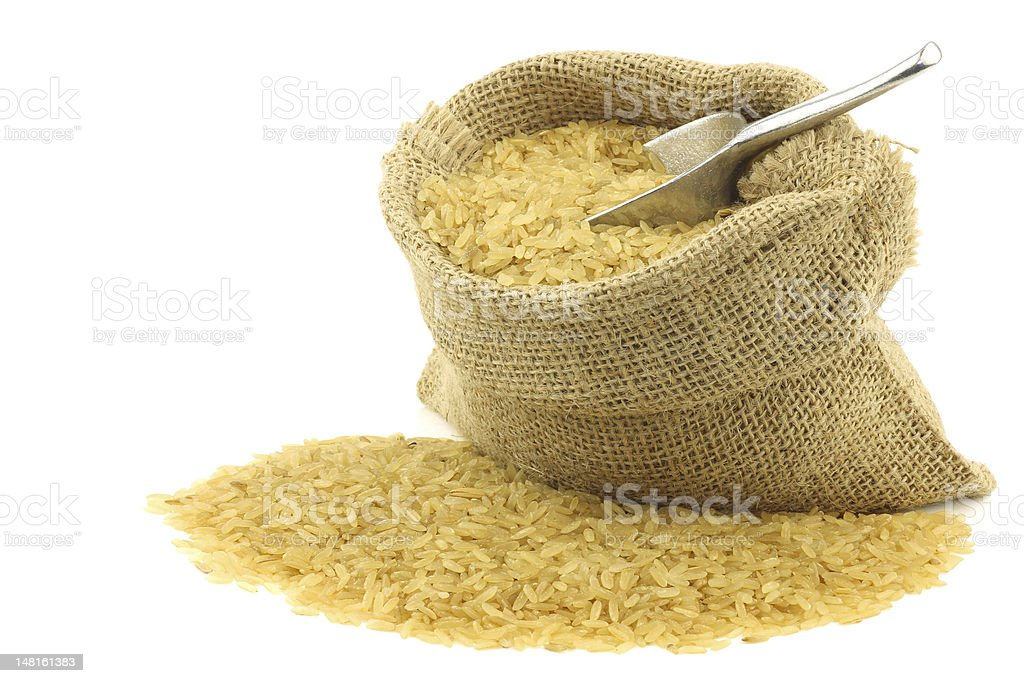 unpolished rice (whole grain) in a burlap bag royalty-free stock photo