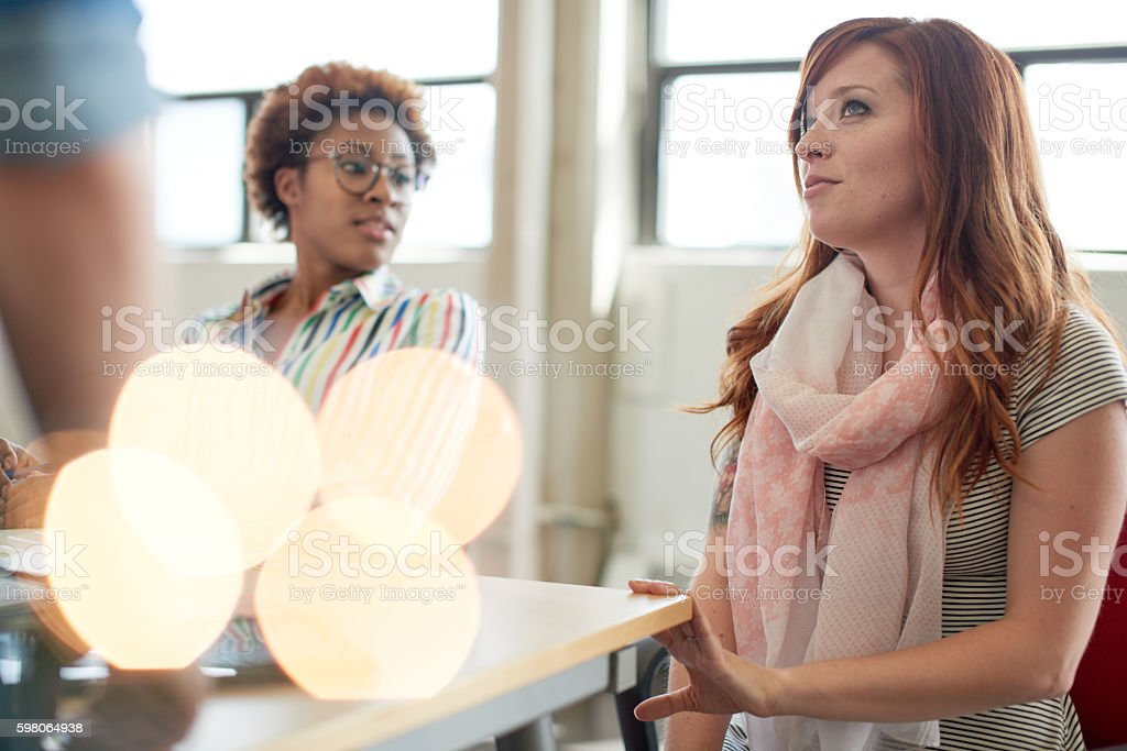 Unposed group of adult student in an open concept  class stock photo