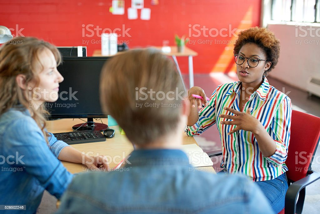 Unposed group of creative business people in an open concept stock photo
