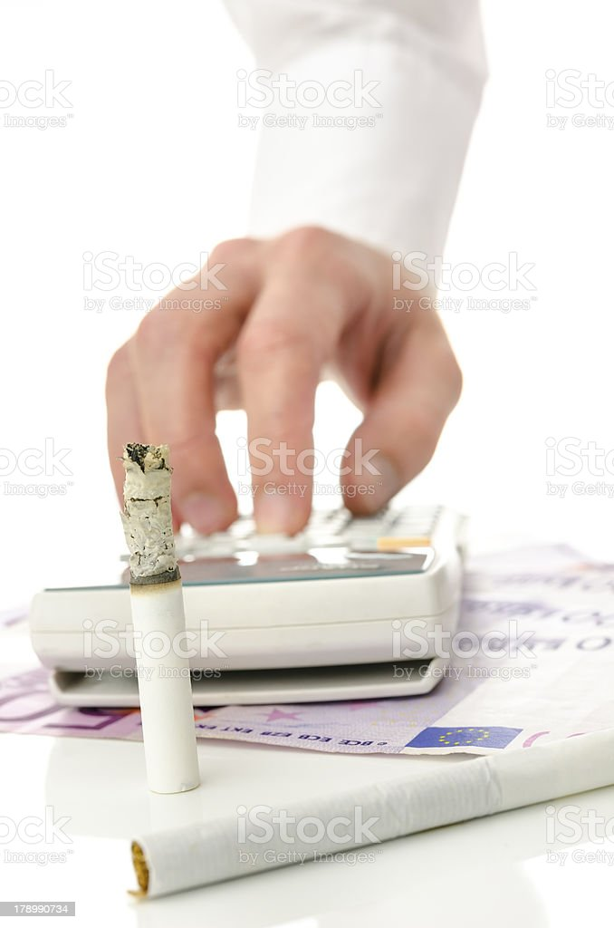 Unreasonable money spending for cigarettes royalty-free stock photo