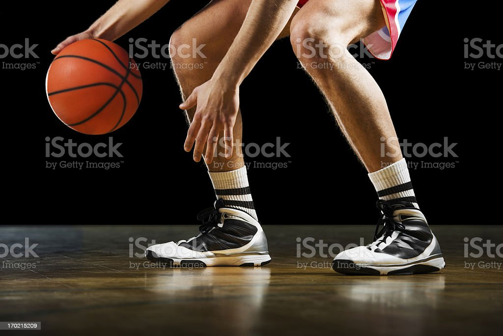 Unrecognizable basketball player dribbling. stock photo